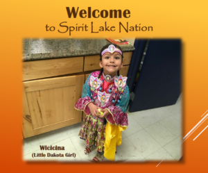 Welcome to Spirit Lake Nation! Orange background and a picture of a young Native girl in cultural clothes